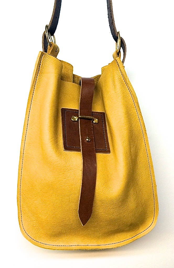 "Big sling in yellow with dk.brown closure  13""w.x 16""h."