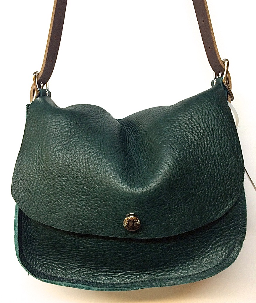 Big sling with button closure $225.in green with golden latigo strap