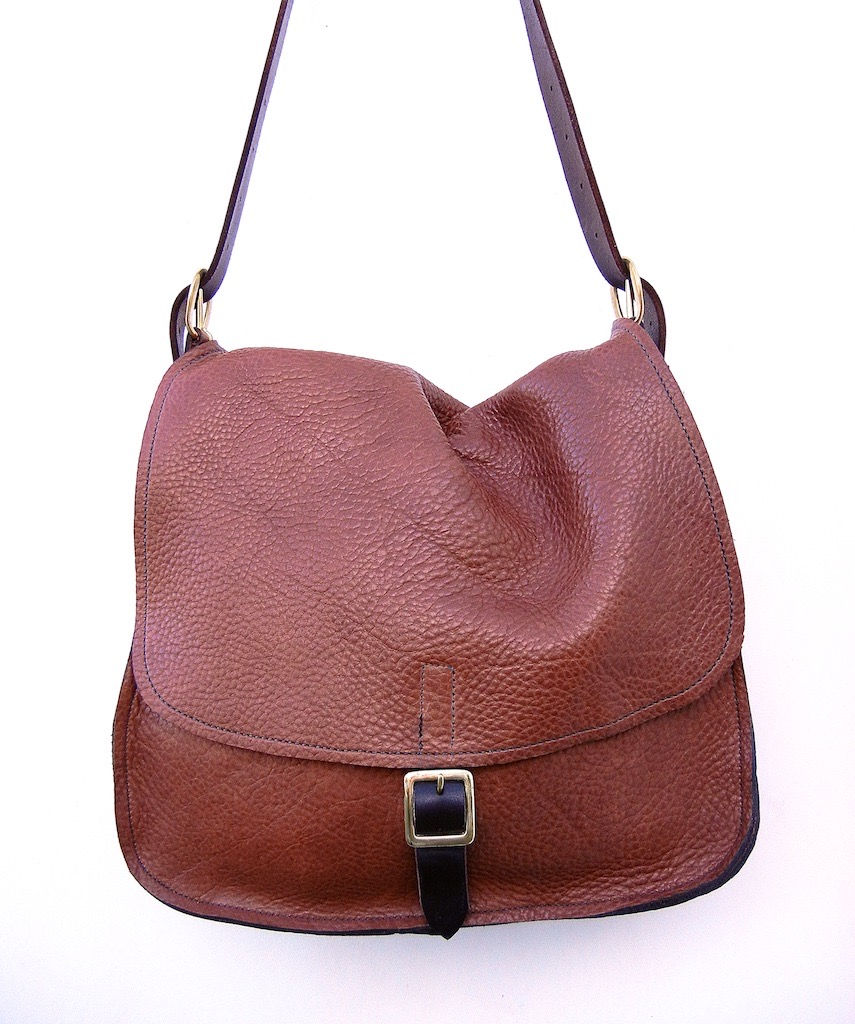 messenger bag in tobacco with one buckle $225